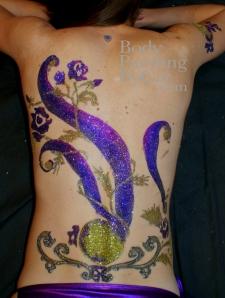 Beijing Club HK Glitter body tattoo; bodypaintingbycat.co.uk; on Symone of poleparadisestudio.com club logo on back wm-1