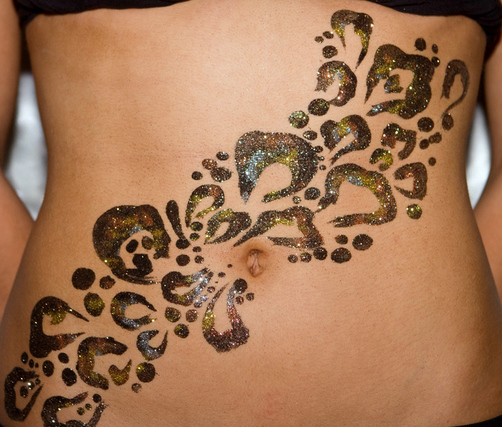 Glitter tattoo art for club dancers.