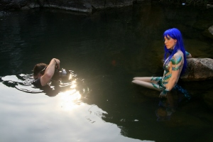 DM mermaid Symone sit in water