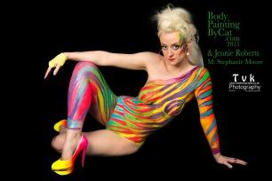 Urban Jungle neon zebra on Steph by Cat Finlayson& Jennie Roberts, TVK photography sat looking logo